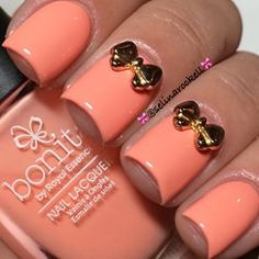 Coral nails with gold bows