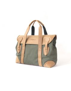 100% cotton canvas body, brass hardware Reinforced leather carry handles Leather flap with simple quick-release stud fastening Fully-lined with zipped internal pocket Full leather base and corners