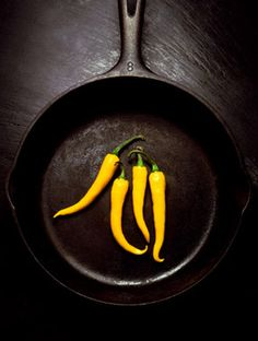yellow chili in pan | vegetables . Gemüse . légumes | Food. Art + Style. Photography: Food on black by Rich Begany |