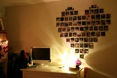 Photo album in the shape of a heart on a wall=great idea