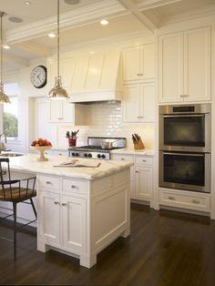 White Kitchen....love the hood.