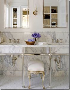love the marble; all it needs is a honeycomb tile floor