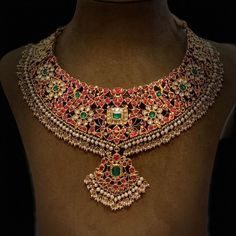 Craftsmanship to adore and intricately developed design by Mangatrai 36 jubileehills. A beautiful KUNDAN necklace with rubies and emeralds made in gold.For details please call or WhatsApp at 18 December 2019 Indian Jewelry Sets, Indian Wedding Jewelry, Bridal Jewelry, Indian Bridal, Gold Jewellery Design, Gold Jewelry, Gold Necklaces, Antique Jewelry, Pearl Necklace Designs