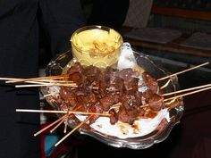 Beef heart marinated, skewered, and seared over the grill. This is a very tipical and popular Peruvian dish. People line up at the good anticucherias (anticucho restaurants) every evening! It takes some work but it is so worth it! I taught myself to make them because I missed them so much! A very special addition to any barbecue party! And the delicious smell will bring over all your neighbors to check it out!