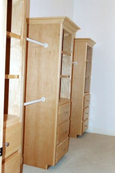 """DL's Closet-Coaching Note: """"Individual cabinets connected with rods make the perfect storage system without having to break the bank."""""""