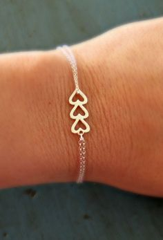 Sterling Silver Heart Bracelet Triple Heart Simple Minimalist Jewelry bridesmaid gifts Sorority Gift. $18.50, via Etsy.