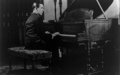 """A young Vladimir Horowitz. NPR: The Piano Titan Returns """"After a self-imposed exile from public performance, pianist Vladimir Horowitz, at age returned to the stage for a performance at Carnegie Hall on May Vladimir Horowitz, Writing Contests, Carnegie Hall, Concert Stage, First Language, Piano Lessons, Childhood Memories, Musicals, Freedom"""