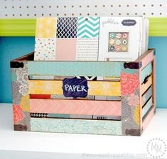 DIY Decoupaged Crate! Such a great idea for paper organization!