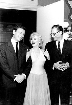 Yves Montand, Marilyn Monroe, and Arthur Miller at a press conference for LET'S MAKE LOVE (1960)