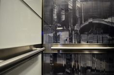 The National Bank in Montréal Celebrated its Cities History of Bold Design, Exciting Event Hosting, and Unique Culture with Commissioned Artwork Customized for Each Elevator Interior. Additional Features Include White Glass Wall Panels with Stainless Inlay Bars, Stainless Handrails, and a Rear Illuminated Ceiling.