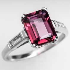 Vintage Rubellite Tourmaline Engagement Ring w/ Baguette Diamond Accents Platinum centered with a 1.90 carat natural emerald cut center stone.