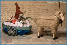Bunny and lamb Easter carriage made out of a paper maché egg.
