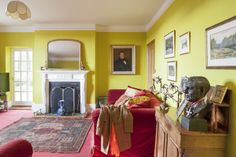 In the Limelight - The living room is a heady mix of velvet reds and luminous limes