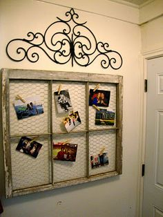 Old window frame turned picture with some chicken wire and clothes pins!!  (i love rustic things)