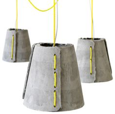 Durable outdoor pendant lamps from  Rainer Mutsch. Crafted from hand-molded fiber-cement shells, they hang from the same rope used for sailboats. They have pure style that can, of course, go indoors too