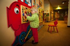 child friendly waiting room   Kid-friendly environment at visual center allows for better eye exam