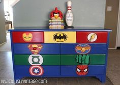 Superhero Logo Painted Drawers - Here's a picture of some drawers painted using stencils. Whoever said simple designs are boring? Don't they look super?