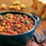 This is different from your typical soup because it has a hearty thickness to it that won't leave you hungry. Served with crunchy corn chips and some of your favorite toppings it is a meal the whole family will enjoy. We love meals like this because they are easily doubled to feed a crowd, and that is what it is all about- spending time with the ones you love!       Used 6-quart slow cooker
