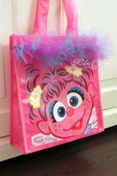 abby bag, saw these bags in the dollar spot at target. Add a little tulle and wala!