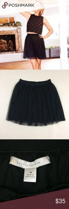 "Lauren Conrad black tulle skirt Medium Lauren Conrad black tulle skirt. Fully lined skirt. Elastic waist. Size Medium. 15""-18"" across elastic waist and 17"" long. LC Lauren Conrad Skirts"