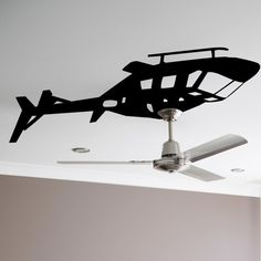 This  Helicopter Ceiling Fan WALLTAT decal is a clever design that uses your existing ceiling fan to serve as the blades of this easy-to-install chopper. This realistic helicopter design is pulling a crafty maneuver overhead that is sure to spark ...