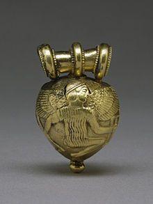 Arte etrusca - Bulla etrusca con Dedalo e Icaro (lato A) Baltimora