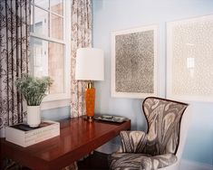 A writing desk and Ikat-covered wing chair in the corner of a living area, designed by Gideon Mendelson.   Lonny.com