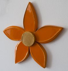 Orange ceramic flower 3d ceramic wall art Dimensions: 28cm x 29cm x 2cm Handmade unique piece made in our small and family studio using traditional processes and committed to the environment. We do ev