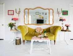 I love the white interior w/ vibrant pops of color. I can't believe that sofa is from Urban Outtfitters!