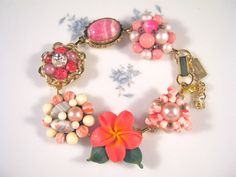This bracelet is soooooooo pretty! Named (of course!) for its Pink Hibiscus earring charm, it is a beautiful statement of watermelon pink.