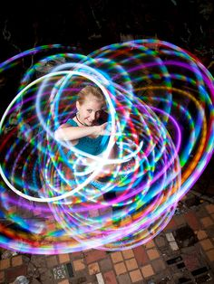 """Jen Web, aka Jennifer Dobrydnia, teleports through the light. A stunning photo by Bryan Karl Lathrop. They live in Philadelphia, Pennsylvania, USA. A Hooping.org Photo of the Day."""