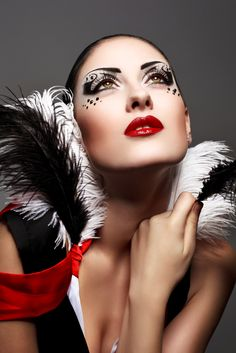 Dramatic black and white artistic eye make-up with crystal accents and feathers.