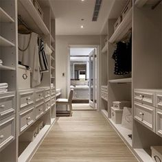 White walk-in closet in the Uptown Castle by GUO Interior Design.  #dressingroom #walkincloset #dreamcloset #closetenvy #interiors #paneling #moulding #wardrobe #luxury #dreamhome #vanity #millwork #interiors #closet #inspiration
