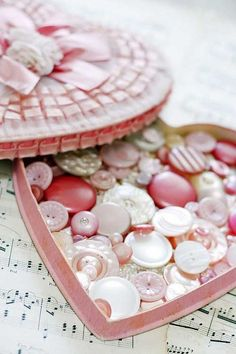 Buttons in an old heart shaped candy box.  Such a sweet idea.