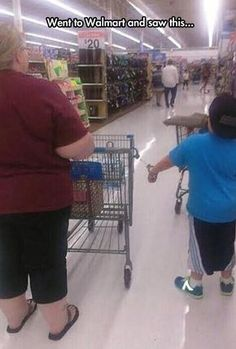 Wal-Mart People Never Disappoint = This kid could easily get his hand out of the cuffs.  He was just trying to cause trouble for Mom....Heehee.