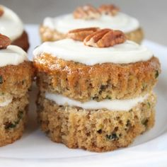 zuchinni muffins 1 cup low-fat plain Greek yogurt {or 1 cup vegetable oil} 3 cups sugar 2/3 cups water 2 cups grated zucchini 4 eggs 3 ½ cups flour 2 tsp baking soda 1 tsp cinnamon Chopped walnuts or pecan 325 degrees 45 min!