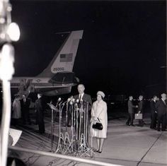 Lyndon Johnson, new President of the United States, speaks at Andrews Air Force Base tonight. Mrs. Johnson [ Lady Bird Johnson ] is beside him. The Johnsons flew to Washington from Dallas in the same plane that brought John F. Kennedy's body to the capital.