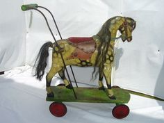 Late 19th century english carved wooden horse on carriage with push along handle