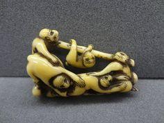 Netsuke. Monkeys on a pole. Made of ivory.
