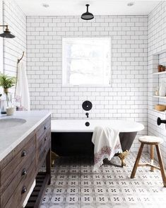 This is -rustic modern farmhouse bathroom with white subway tile, black claw foot tub, patterned tile floor and restoration hardware vanity. Modern Farmhouse Bathroom, Urban Farmhouse, Rustic Farmhouse, Farmhouse Style, Farmhouse Furniture, Craftsman Bathroom, American Farmhouse, Farmhouse Windows, Farmhouse Design