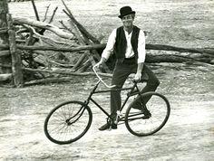<> Paul Newman rides a bike.