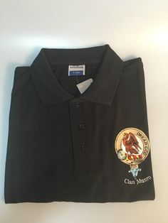 Black cotton polo shirt with embroidered Munro clan crest. XL black. Discontinued line - last one available.