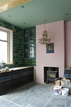 A beautiful vintage chandelier and pink and green walls in our new London showroom