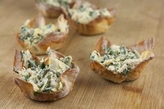 Baked wonton wrappers filled with a tasty spinach and artichoke mixture. Perfect for entertaining!