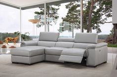 Light grey leather sectional with unique wrap-around armrest. The sectional is constructed with extra padded seats for maximum comfort. This elegant and comfortable sofa set is an ideal choice for today s living room. With its soft, welcoming shapes and a sectional configuration, the sofa is availab...