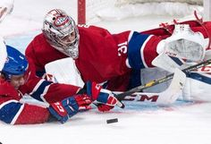 Montreal Canadiens defenseman Shea Weber helps goalie Carey Price as they face the Los Angeles Kings during the third period of an NHL hockey game Thursday, Nov. 10, 2016, in Montreal. (Paul Chiasson/The Canadian Press via AP)
