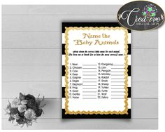 This is NAME The BABY ANI.... Go see it here http://snoopy-online.myshopify.com/products/name-the-baby-animals-baby-shower-game-with-black-white-stripes-color-theme-printable-glitter-gold-digit-jpg-pdf-instant-download-bs001