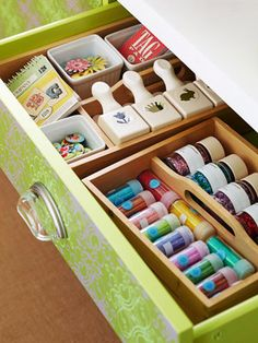 Tidy Drawer Solution- Drawer organizers keep small goodies from getting out of control. These wooden trays feature integrated handles so you can easily transport them from drawer to tabletop.    Editor's Tip: Don't want to spend money on a drawer organizer? Use an egg carton painted a bright color to hold small items.