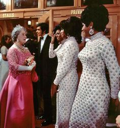 Diana Ross and The Supremes are presented to Her Majesty Queen Elizabeth the Queen Mother after performing at 1968's Royal Variety Command Performance.