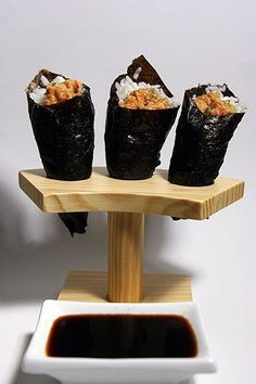 Yesterday I covered the different types of sushi, and one of these was the temaki, or hand roll. This cone-shaped wrap of seaweed sheet (nori) is filled with vinegared rice and various ingredients. In this post I'll explain how to make one.